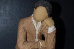 Escultura: hombre en actitud pensativa